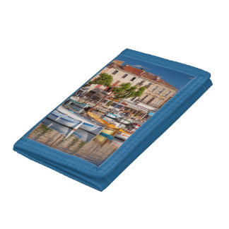 Colorful boats in the small harbor tri-fold wallet