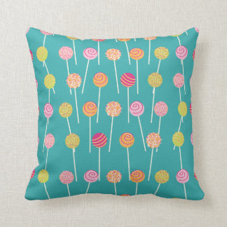 Colorful Cake Pops on Teal Pattern Cushion