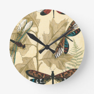 Colorful Dragonflies Floating Above Leaves Round Clock