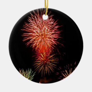 Colorful fireworks of various colors light up the round ceramic decoration