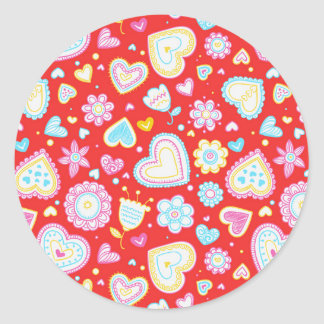 Colorful hearts and flowers pattern round sticker