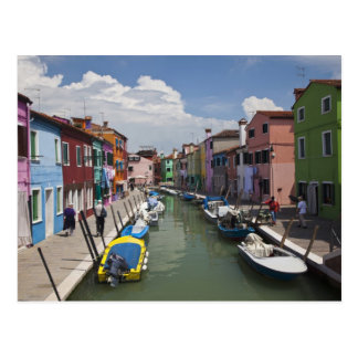 Colorful homes along canal on the island of postcard