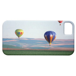 Colorful hot air balloons float over wheat iPhone 5 case
