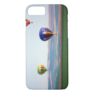 Colorful hot air balloons float over wheat iPhone 8/7 case