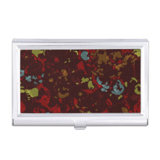 Colorful leaves and flowers against camouflage business card holder