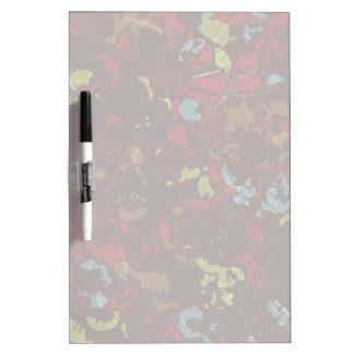 Colorful leaves and flowers against camouflage dry erase board