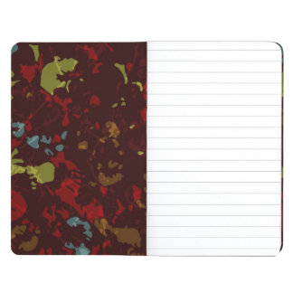 Colorful leaves and flowers against camouflage journal