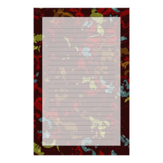 Colorful leaves and flowers against camouflage stationery paper