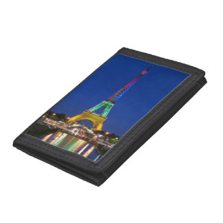 Colorful light display on the Eiffel Tower Trifold Wallet