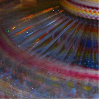 Colorful night fair ride action spinning shot photo sculpture badge