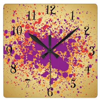 Colorful paint splattters clocks