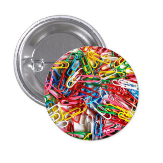 Colorful paper clips on white background. 3 cm round badge