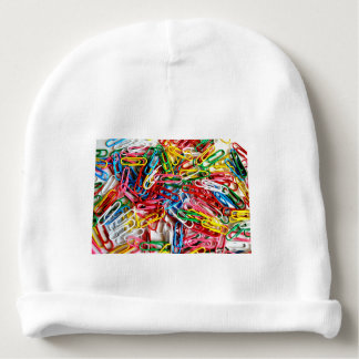 Colorful paper clips on white background. baby beanie
