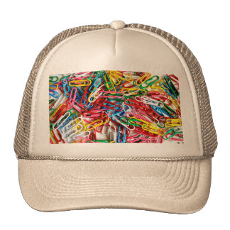 Colorful paper clips on white background. cap