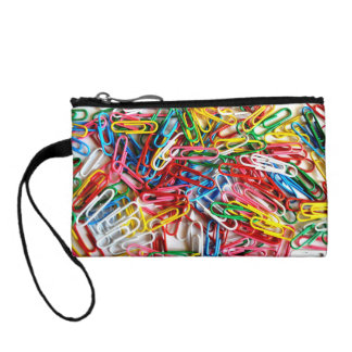 Colorful paper clips on white background. coin wallets