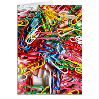 Colorful paper clips on white background. note card