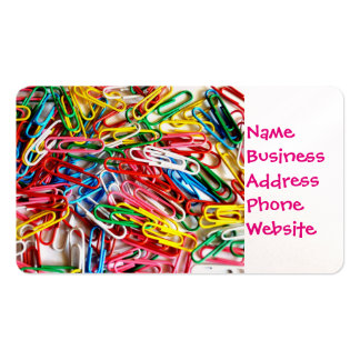 Colorful paper clips on white background. pack of standard business cards