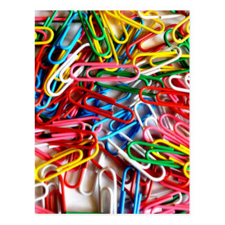 Colorful paper clips on white background. postcard