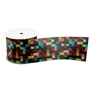 Colorful pieces on a black background satin ribbon