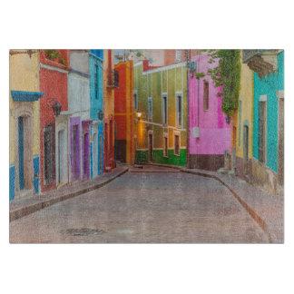 Colorful street scene cutting board