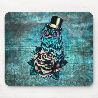Colorful textured owl illustration on teal base. mouse mat
