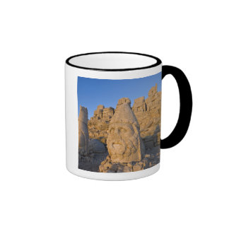 Colossal head statues of Gods guarding the Ringer Coffee Mug