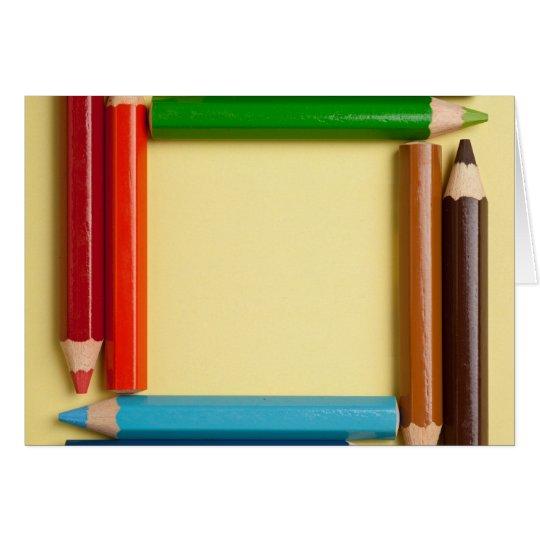 Colour pencils forming a square frame card