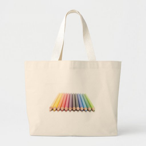 Coloured pencils in a rainbow tote bag