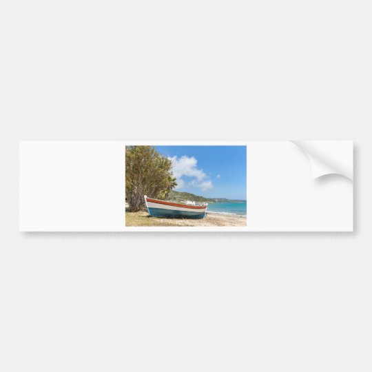Colourful boat lying on greek beach bumper sticker