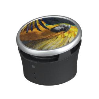 Colourful flying Ara on a dark background Bluetooth Speaker