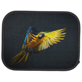 Colourful flying Ara on a dark background Car Mat