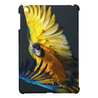 Colourful flying Ara on a dark background iPad Mini Case