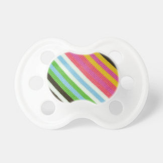 Colourful knitted background baby pacifier