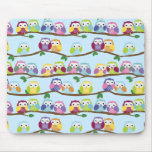 Colourful owls on a branch mouse pad