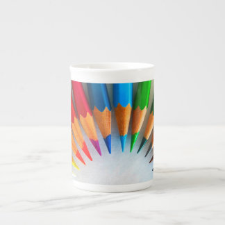Colourful pencils tea cup