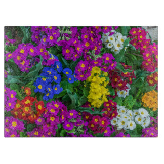 Colourful primroses glass cutting board