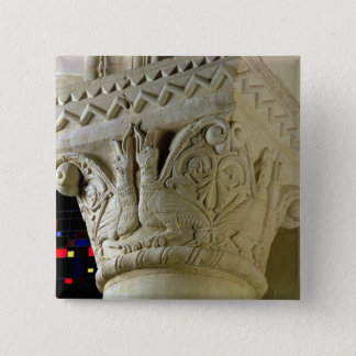 Column capital bearing symmetrically arranged grot 15 cm square badge