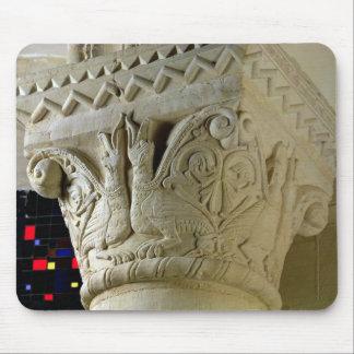 Column capital bearing symmetrically arranged grot mouse mat