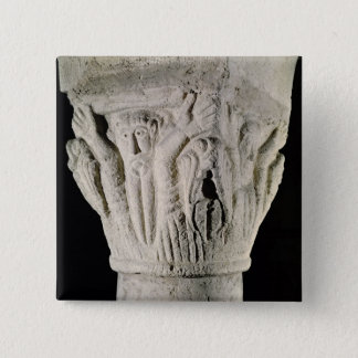 Column capital with a man with raised arms 15 cm square badge