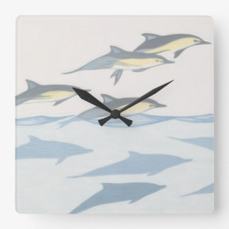 Common Dolphins Wall Clock