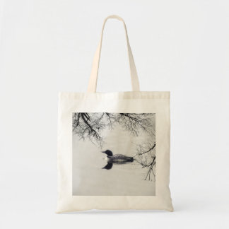 Common Loon Swims in a Northern Lake in Winter Tote Bag