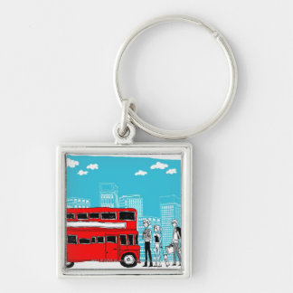 Commuters waiting at bus stop key ring