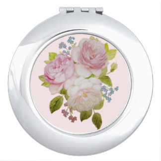 Compact mirror of faint rose and forget-me-not
