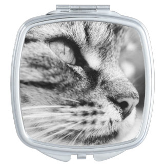 Compact mirror with black and white cat picture.