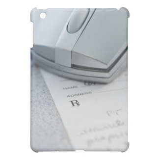 Computer mouse on written prescription iPad mini covers