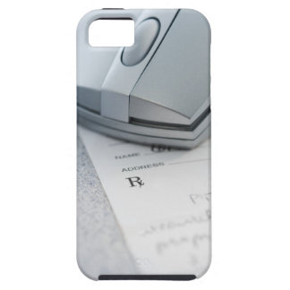 Computer mouse on written prescription iPhone 5 cover