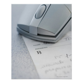 Computer mouse on written prescription poster