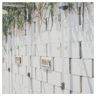 Concrete wall with vines hanging from top fabric