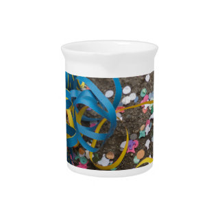 confetti and streamers at carnival beverage pitcher