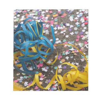 confetti and streamers at carnival notepads